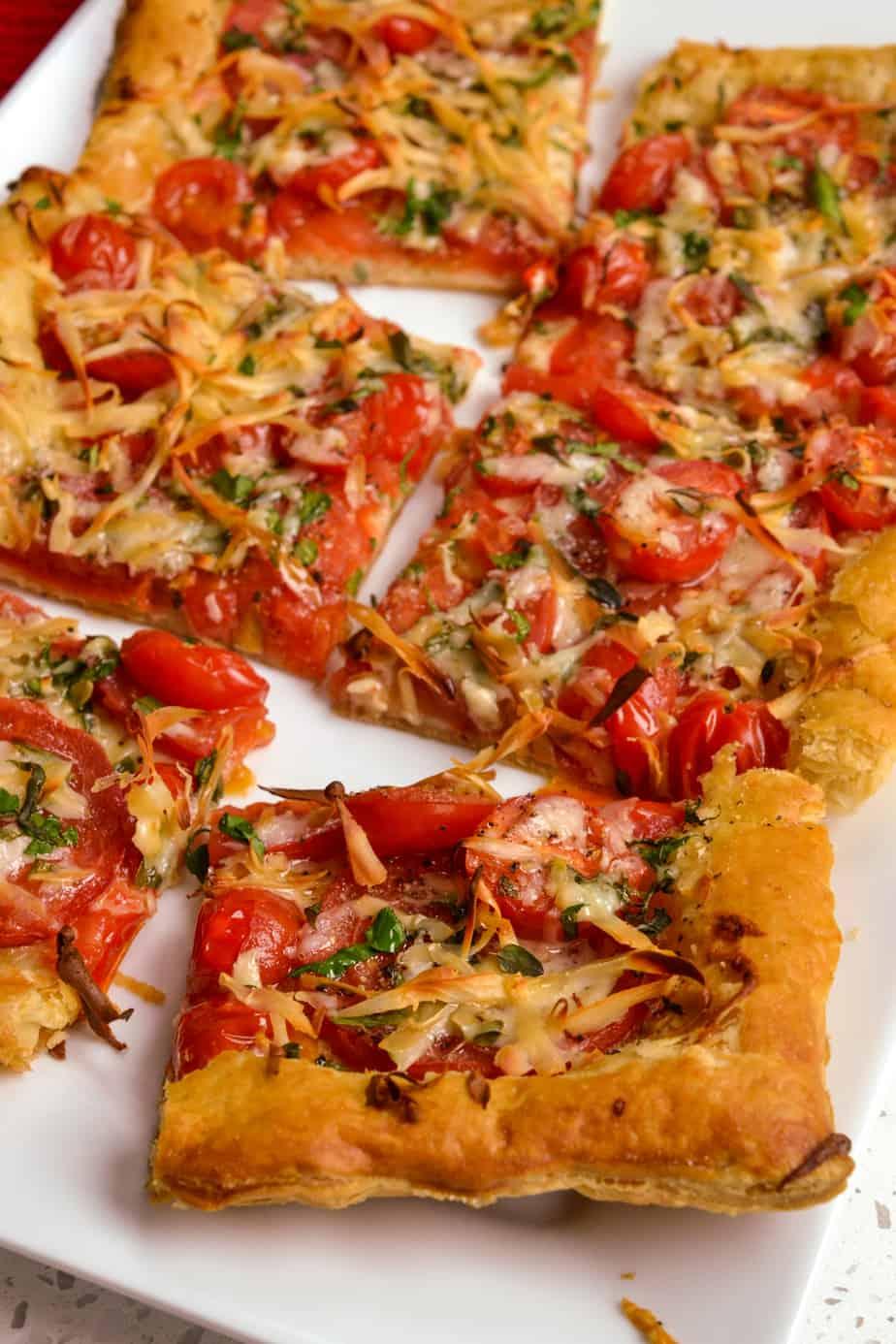 Sliced tomato tart with fresh herbs