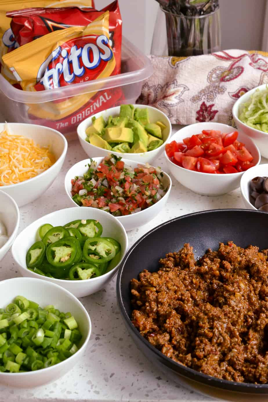 Walking taco bar with assorted toppings