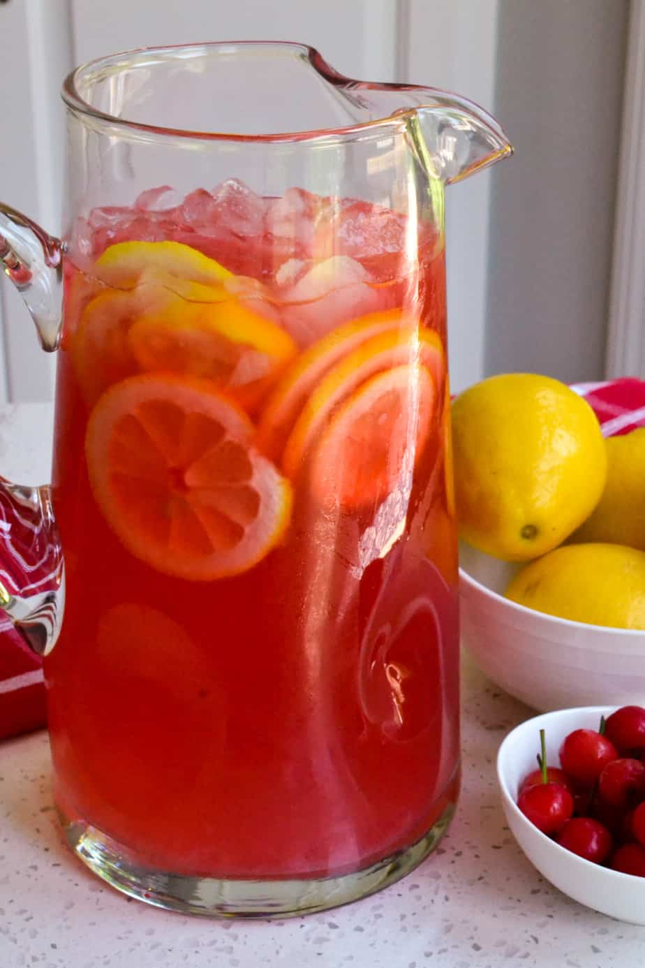 A pitcher of cherry lemonade.