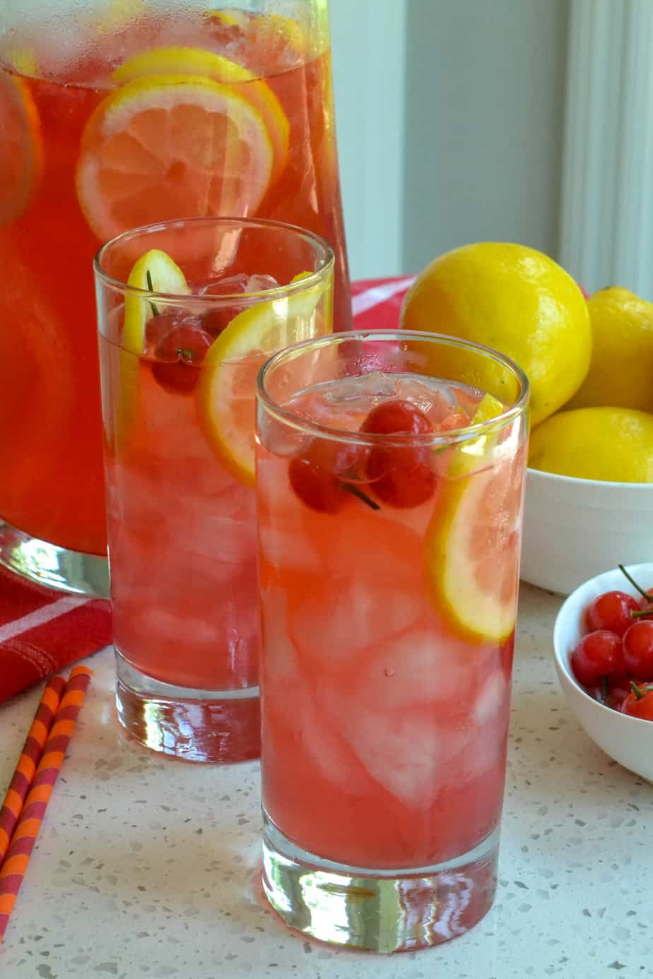 Glasses full of ice cold cherry lemonade.
