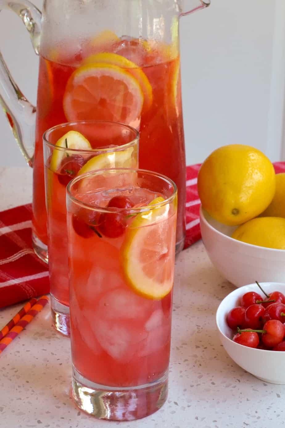 Refreshing cherry lemonade garnished with fresh cherries and lemon slices.