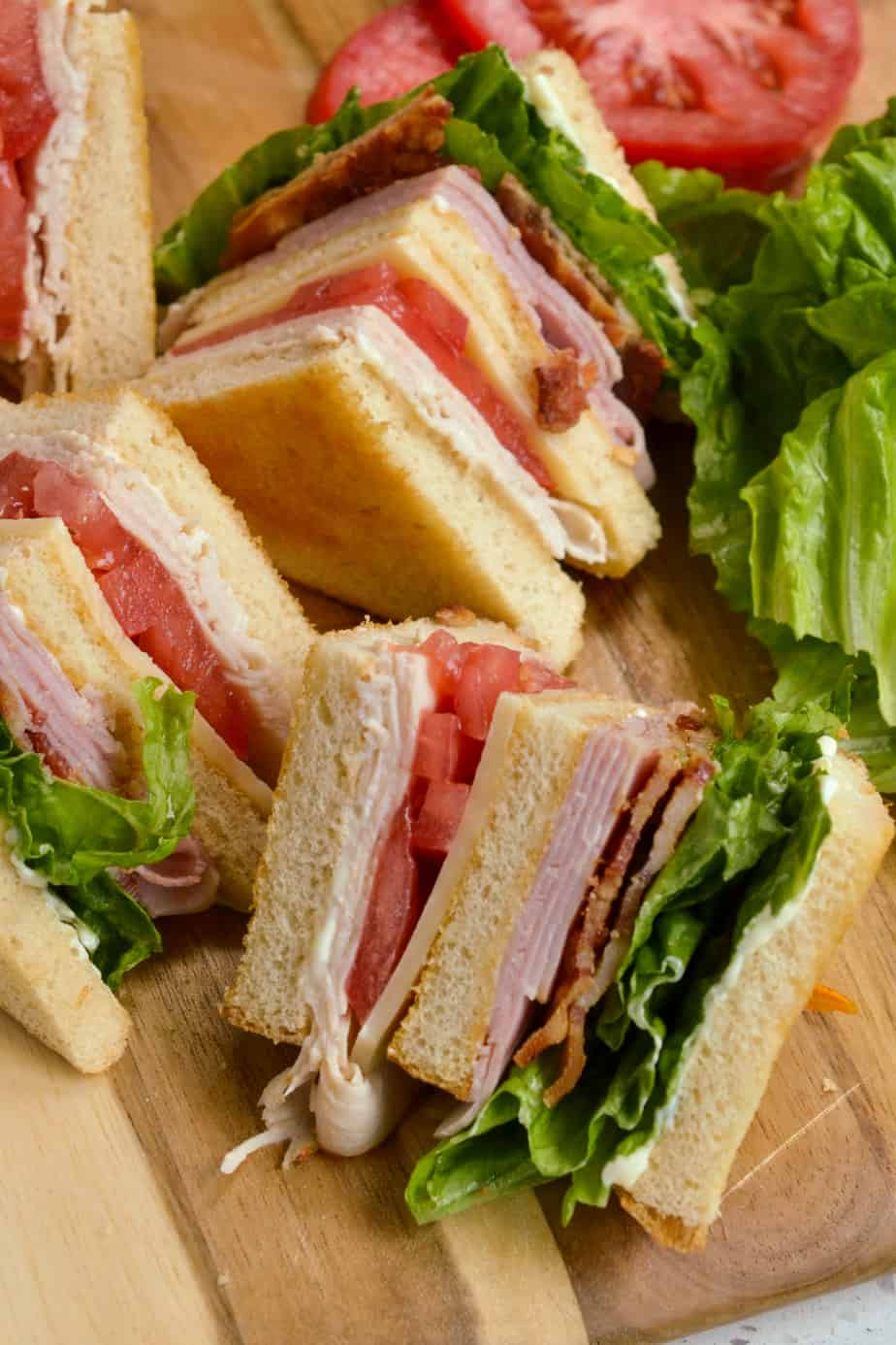 A triple layer classic club sandwich with bacon