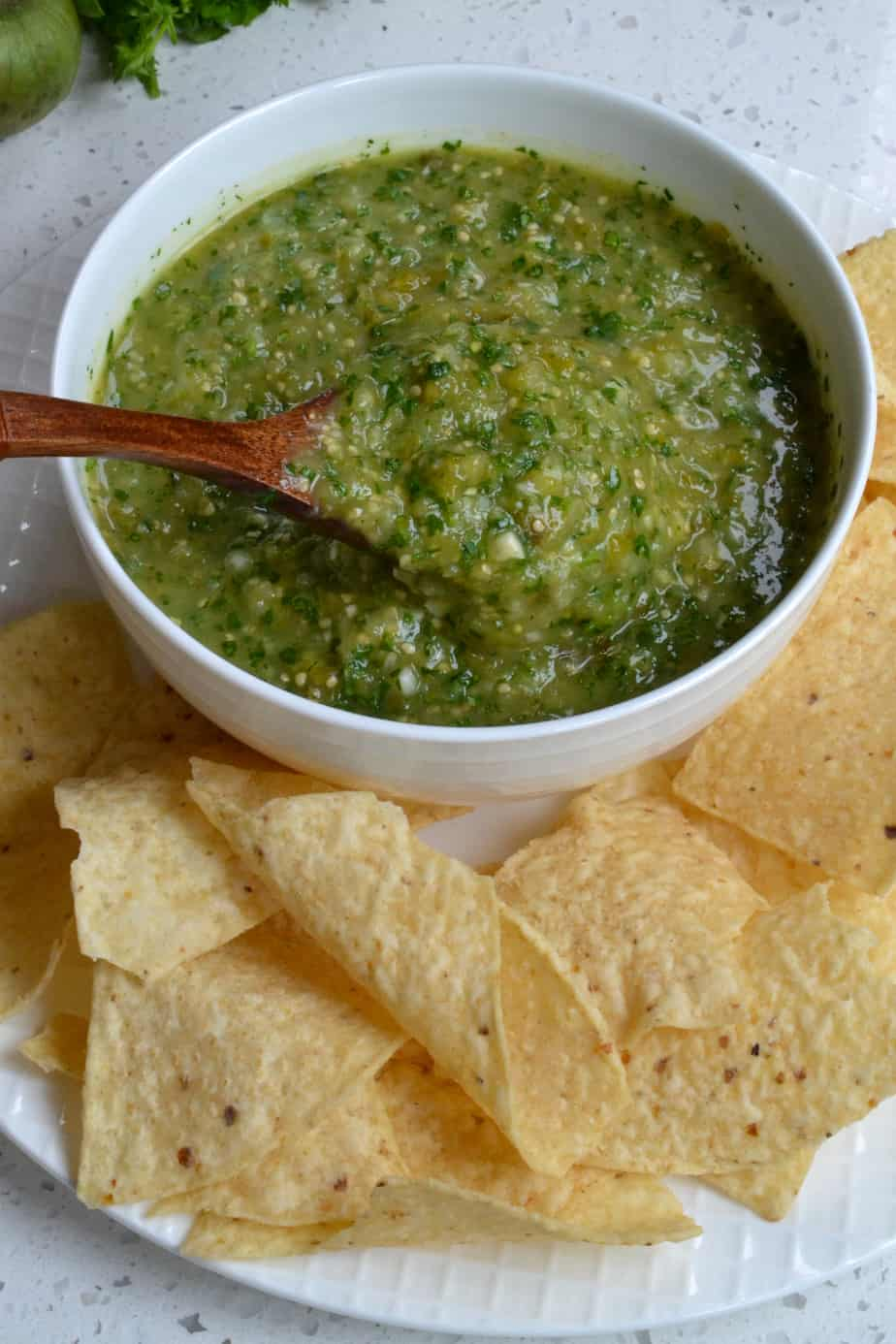 A spoonful of fresh salsa made from tomatillos.