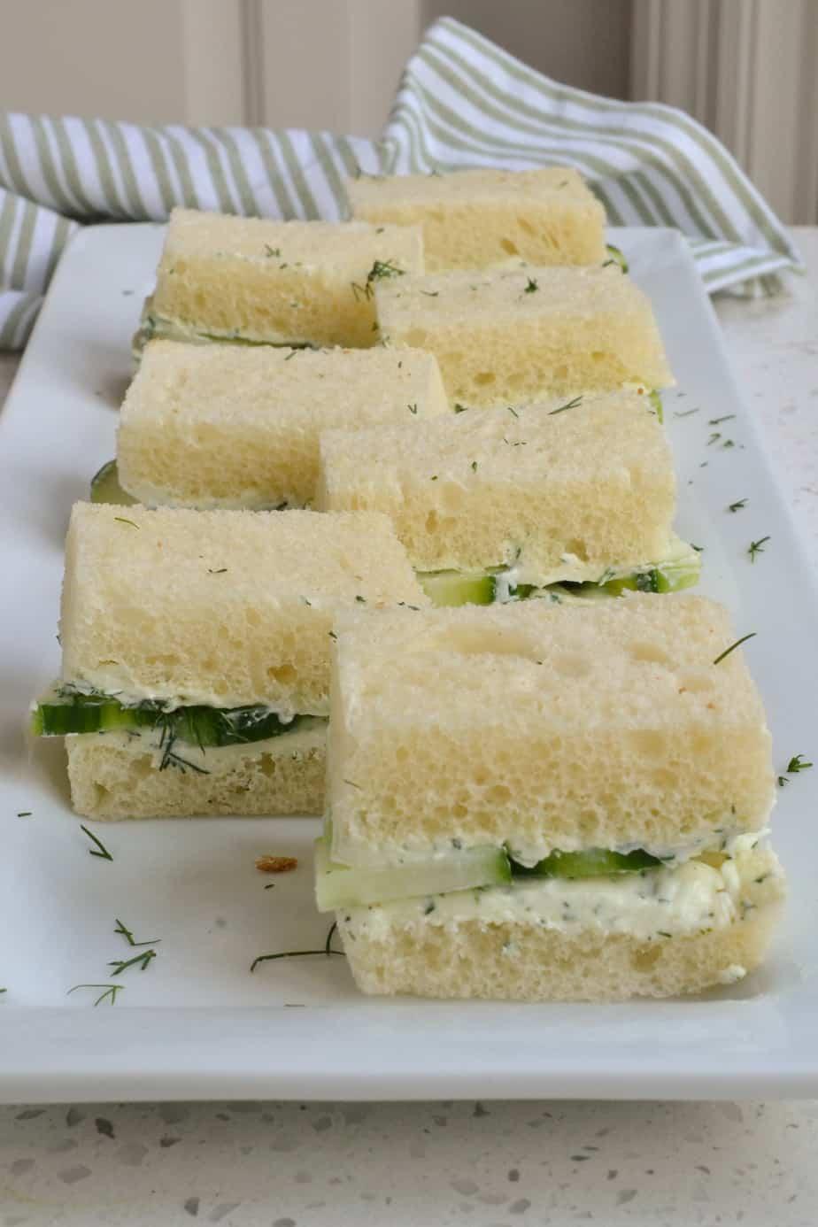 A platter full of cucumber sandwiches.