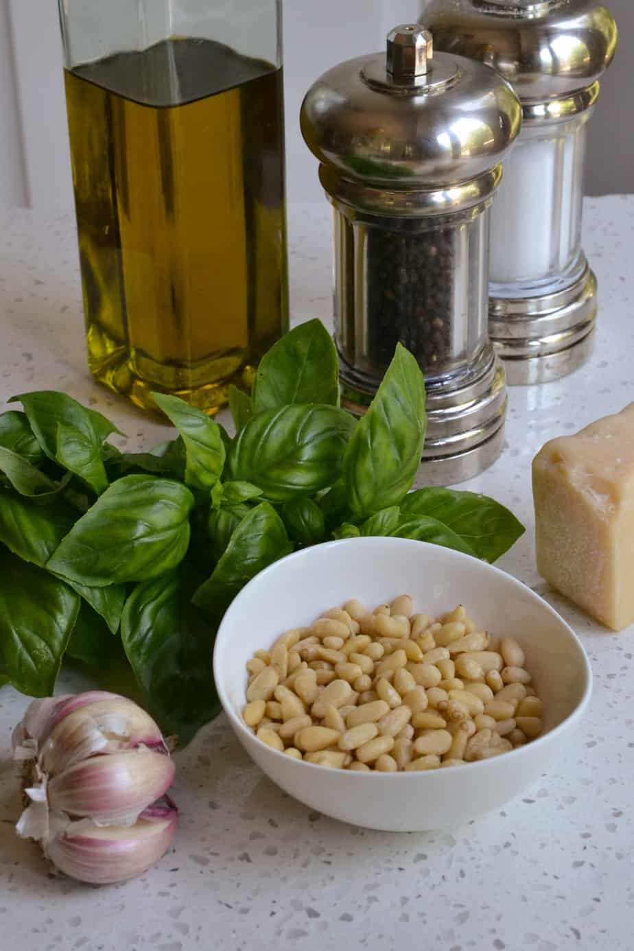 Pesto sauce is made with pine nuts, basil, garlic, Parmesan Cheese, and olive oil.