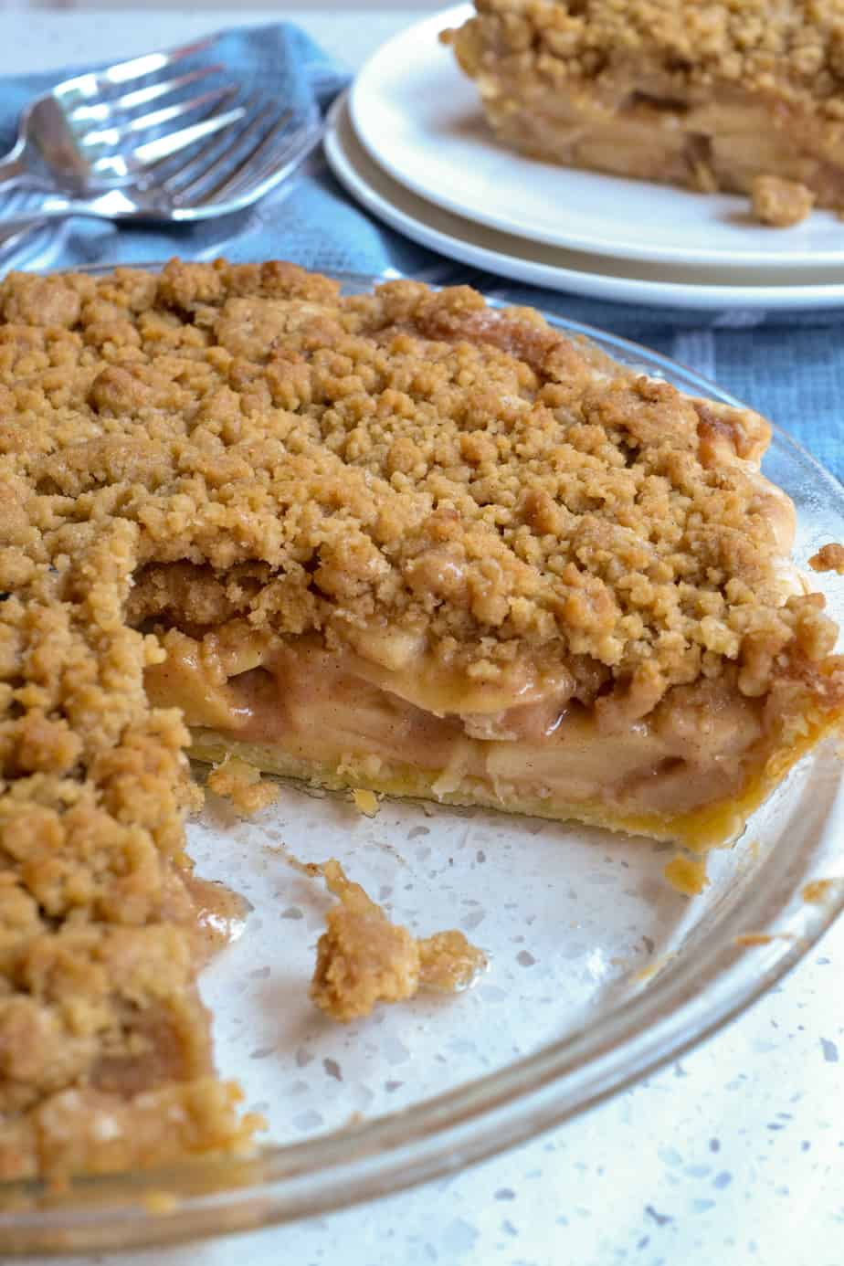 An Apple Crumb Pie with a slice cut out of it.