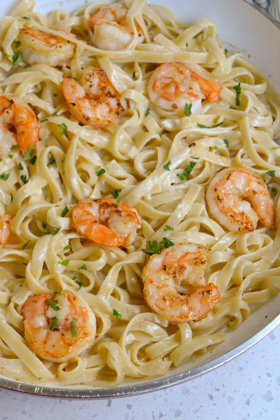 A skillet full of homemade shrimp alfredo.