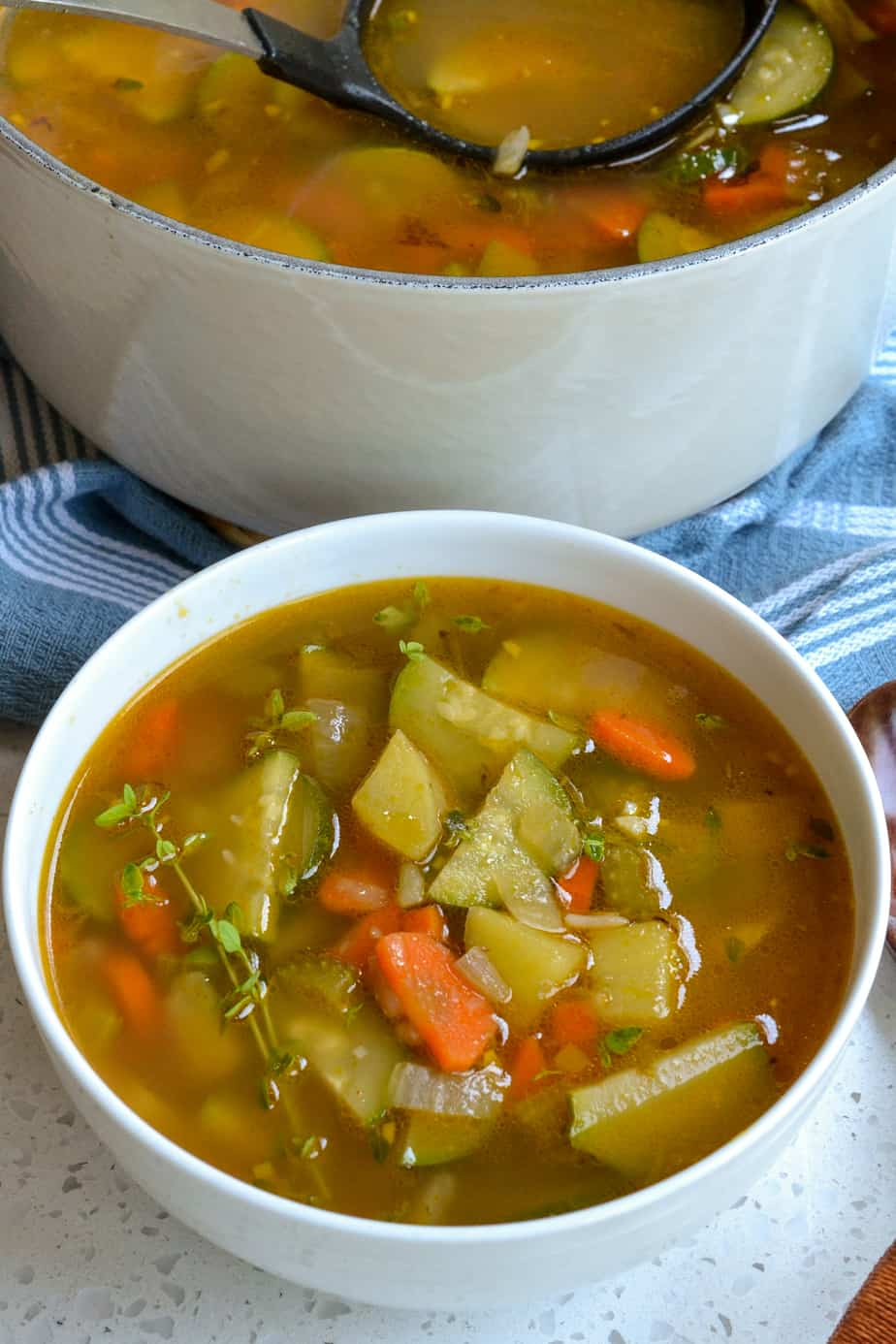 A bowl full of zucchini vegetable soup.