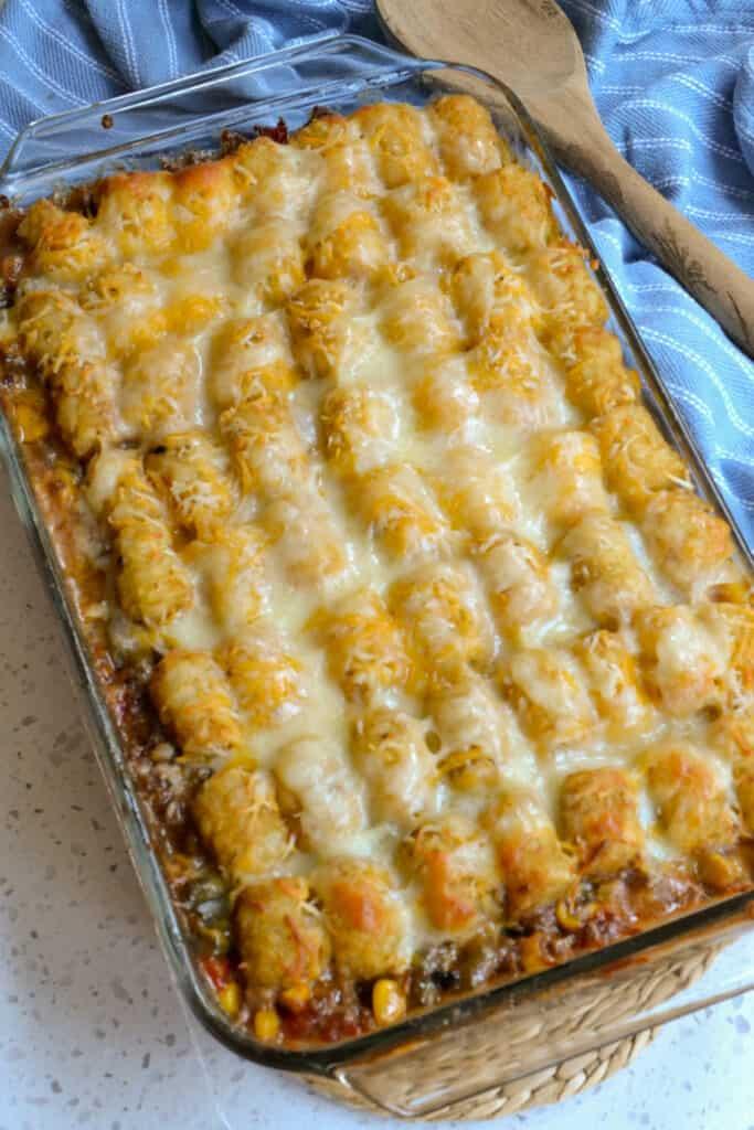 A dish full of cheesy tater tot cowboy casserole.
