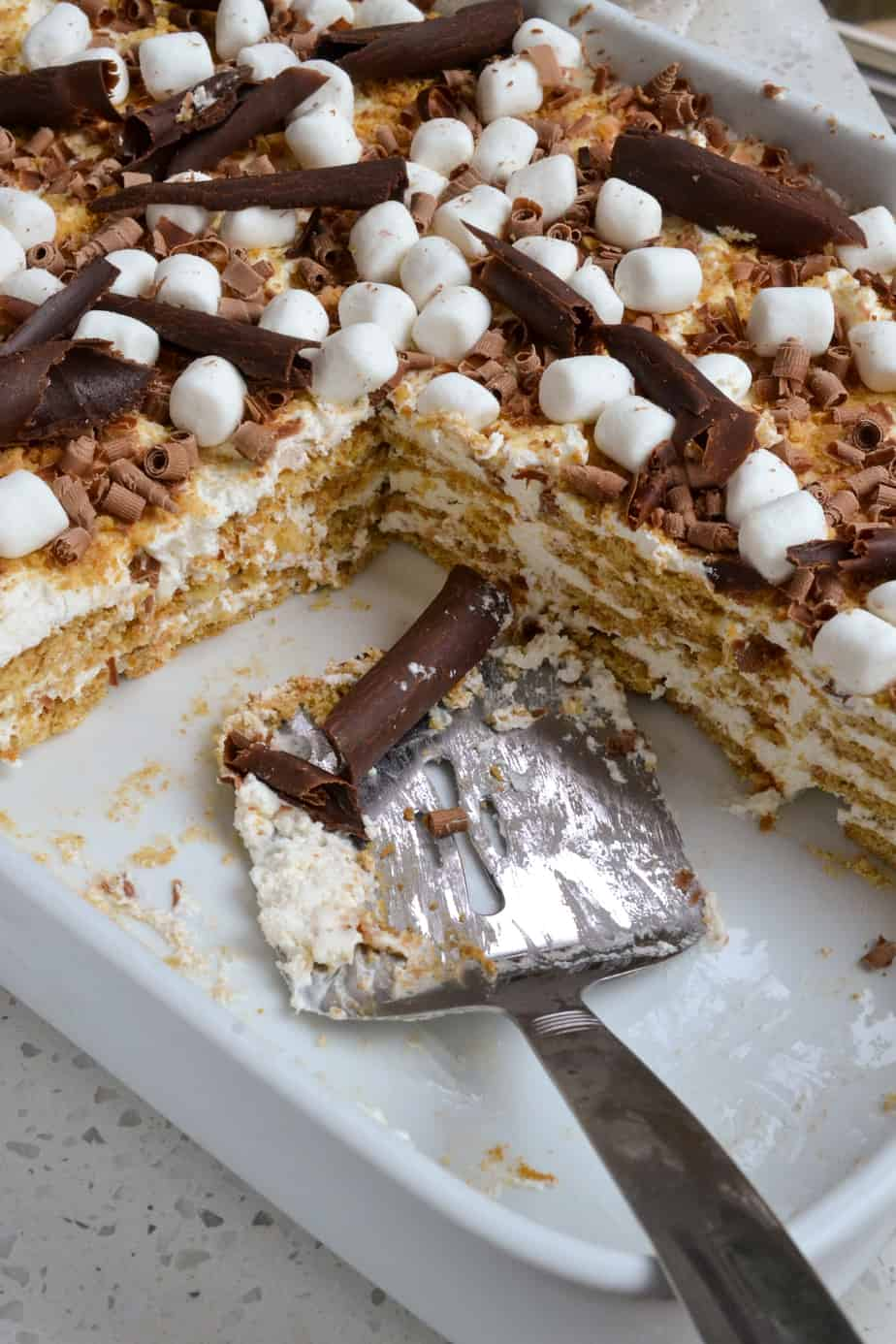 A pan full of Icebox Cake made with graham crackers and whipped cream.