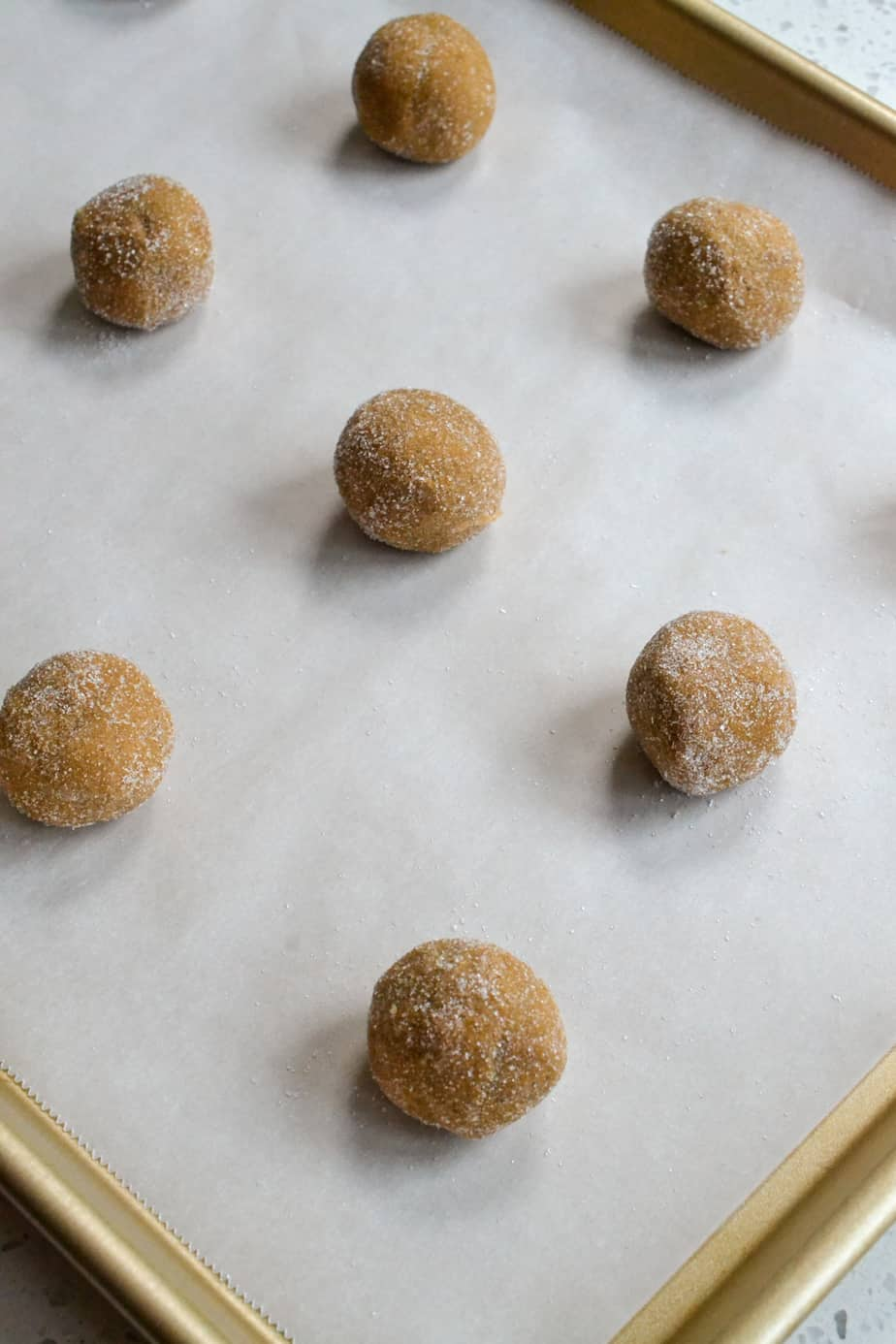 Roll the dough into balls and place on parchment covered baking sheets.