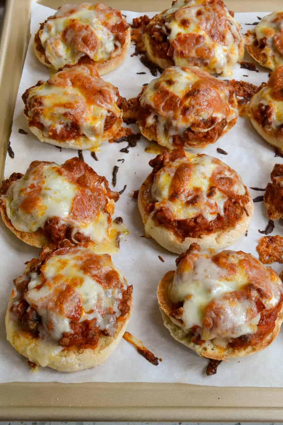 English muffins topped with browned hamburger, onions, marinara, and cheese.