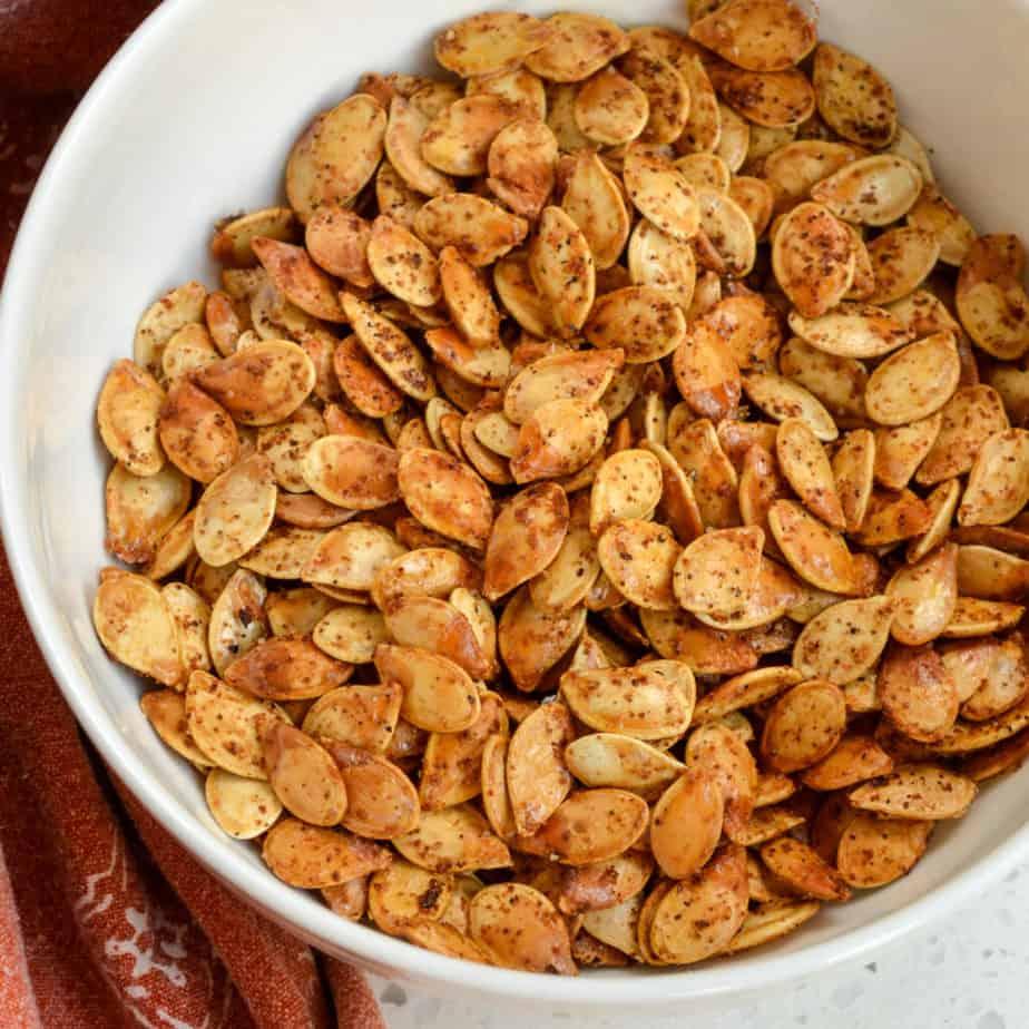 A bowl full of crispy roasted pumpkin seeds.