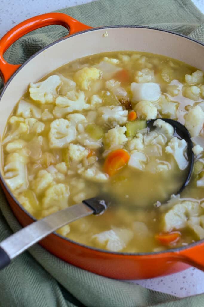 Simmer the cauliflower in chicken broth until fork tender.