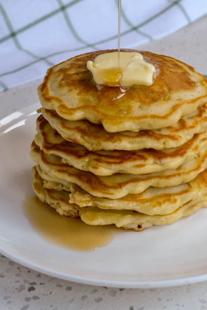 Warm syrup drizzled over hot buttermilk oatmeal pancakes.